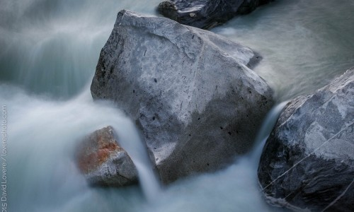 High water flowing over large granite boulders, South Yuba River, CA